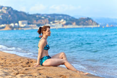 Middle age woman on a beach Stock Photos
