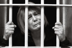 Middle Age Woman Behind Bars Stock Photo