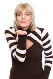 Middle age woman blowing air kiss. Isolated on white Stock Photos