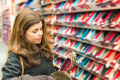 Middle age woman buying shoes in a store Stock Photography