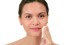 Middle age woman with a cleansing puff Royalty Free Stock Images