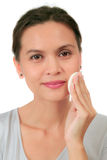 Middle age woman with a cleansing puff. Isolated middle age woman with a cleansing puff Royalty Free Stock Images