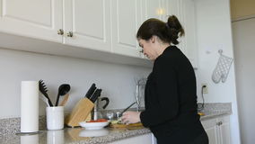 Middle age woman cooking at home Royalty Free Stock Photography
