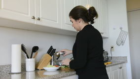 Middle age woman cooking at home Stock Image