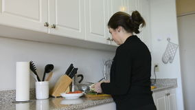 Middle age woman cooking at home Royalty Free Stock Images