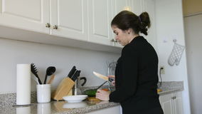 Middle age woman cooking at home Stock Photo