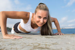 Middle age woman doing push ups Royalty Free Stock Image