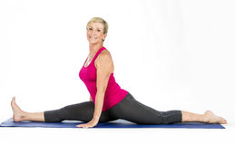 Middle age woman doing split exercises Stock Image