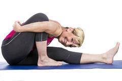 Middle age woman doing yoga exercises Royalty Free Stock Image