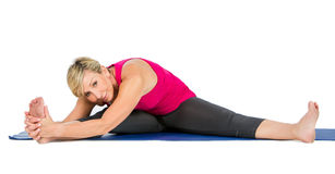 Middle age woman doing yoga exercises stock images