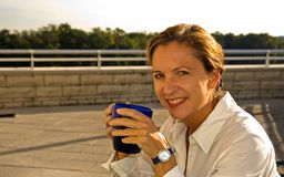 Middle Age Woman Drinking Coffee royalty free stock photography
