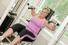 Middle age woman exercise Stock Photos