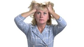 Middle age woman with headache touching her head. Terrible head pain. Extremely tired and stressed mature woman in white isolated background stock video footage