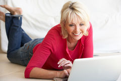 Middle age woman on her laptop computer. At home Stock Photo