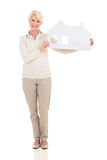 Middle age woman holding paper house Royalty Free Stock Photos