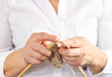 Middle age woman knitting Stock Image