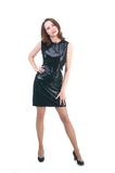 Middle age woman in a little black dress on white background Royalty Free Stock Image
