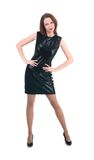 Middle age woman in a little black dress on white background Royalty Free Stock Photos