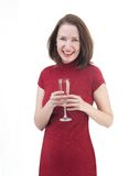 Middle age woman in a little red dress on white background Stock Photo
