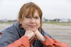 Middle age woman outdoors. Portrait of a middle age woman outdoors royalty free stock images
