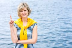 Middle age woman outdoors with finger up Stock Photo