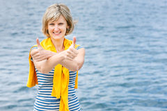 Middle age woman outdoors gesturing thumb up Stock Image