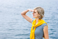 Middle age woman outdoors  looking in distance Stock Photography