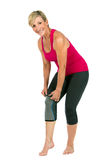 Middle age woman with patellar knee brace Stock Image