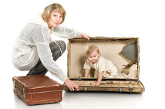 Middle age woman playing with little child Stock Photos