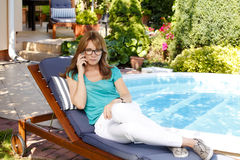 Middle age woman portrait a garden Stock Photo