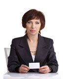 Middle age woman showing card Royalty Free Stock Image
