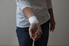 Middle age woman showing her bandaged wrist. Royalty Free Stock Photo