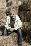 Middle Age Woman Sitting on Bales of Straw Stock Photography