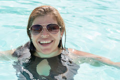Middle age woman in a swimming pool Royalty Free Stock Image