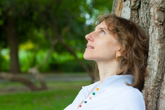 Middle age woman thinking Royalty Free Stock Photo