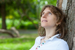 Middle age woman thinking Stock Photography