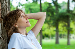 Middle age woman thinking Stock Images