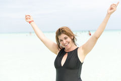 Middle age woman in tropical beach Royalty Free Stock Photos