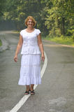 Middle age woman walk Royalty Free Stock Images