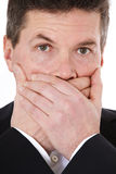Middle-aged человек держит его рот закрыно стоковое изображение
