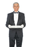 Middle aged Adult Male Wearing Tuxedo. Middle Aged Butler Wearing a Tuxedo and holding an empty platter isolated on white Stock Image