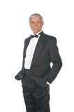 Middle aged Adult Male Wearing Tuxedo. Middle Aged Adult Male Wearing a Tuxedo with hands in pockets isolated on white Royalty Free Stock Photos