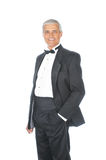 Middle aged Adult Male Wearing Tuxedo. Middle Aged Adult Male Wearing a Tuxedo with one hand in pocket isolated on white Stock Images