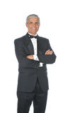 Middle Aged  Adult Male Wearing Tuxedo. Middle Aged Adult Male Wearing a Tuxedo with arms folded in front of body isolated on white Royalty Free Stock Photos