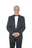 Middle Aged  Adult Male Wearing Tuxedo. Middle Aged Adult Male Wearing a Tuxedo with hands in front of body isolated on white Stock Images