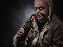 Middle aged alcoholic and wine bottle Stock Photo