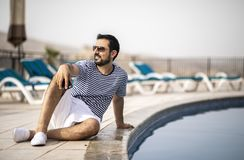 Middle aged arab man by a pool Royalty Free Stock Photo