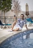 Middle aged arab man by a pool Royalty Free Stock Images