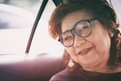 Middle aged asia woman. Happiness senior aged asia woman in a car Royalty Free Stock Image