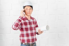 Asian architect at construction site office stock image